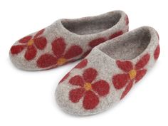 Handmade solid-rolled felt slippers. 100% wool. Designed for wide feet. High backs help them to fix to the foot. Flowers with scarlet petals on a bright base will prop you up every time your eyes stop on them.