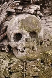 Gravestone With A Stone Skull