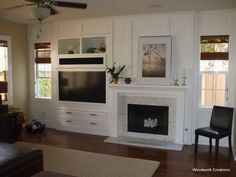 TV is not over fireplace; like how the vertical trim pieces over the fireplace unifies the builtin with the TV. Off Center Fireplace, Fireplace Feature Wall, Fireplace Wall, Fireplace Surrounds, Fireplace Design, Wall Fireplaces, Family Room Walls, Family Room Fireplace, Fireplace Built Ins