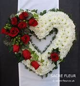 Resultado de imagem para Open heart funeral arrangement