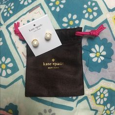 New with tag Kate Spade pearl and gold studs Brand new Kate spade pearl studs with gold accents. Comes with original tags and dust bag. Offers welcome! kate spade Jewelry Earrings