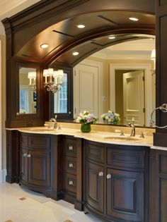 Gorgeous!  Twin vanity unit with lots of storage and overhead arch.  The lighting is beautiful, with recessed lights in the arch and sconces on the custom mirror.
