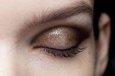 Brown shimmer eye shadow.