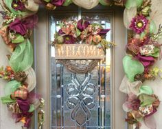 Decorate your front door with this 10 1/2 Custom Fall Garland made with deco mesh and burlap wired ribbon and fall florals. (Wreath not included). Each Garland is custom made, If you need a different size or color please message me. I would be happy to makes something special for you.