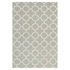 Create a beautiful focal point in your foyer, living room, or master suite with this eye-catching rug, artfully crafted for lasting style.  Product: RugConstruction Material: WoolColor: Grey and ivoryFeatures:  Made in IndiaHand-tufted Note: Please be aware that actual colors may vary from those shown on your screen. Accent rugs may also not show the entire pattern that the corresponding area rugs have.Cleaning and Care: Professional cleaning recommended