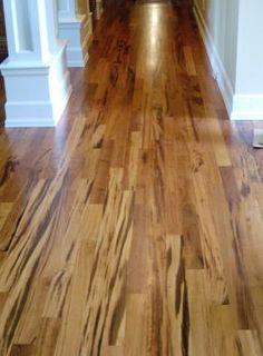 tiger wood floor. Love that it mixes dark & light