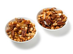 Get this all-star, easy-to-follow Indian-Spiced Nuts With Coconut recipe from Food Network Magazine.