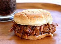 there are only 3 ingredients to these super simple pork sandwiches. And if you don't have a recipe for pulled pork sandwiches, this is the one for you. The pork is cooked in root beer all day long. You could use any flavor of soda really like Dr.Pepper or Coke but I prefer root beer. The root beer acts as a tenderizer and after soaking in it all day, the pork practically melts in your mouth. After cooking, drain the root beer and add your favorite BBQ sauce to the shredded meat. I used a pork tenderloin here but you could use a pork shoulder or butt which have more flavor but also more fat to pick out.