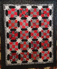 """'Wonky 9-patch Two Toned' This is a fun, easy quilt to cut and piece.  The block is 'wonky nine-patch"""" and uses only 2 fabrics per block'.  The sashing includes 'wonky stars'."""