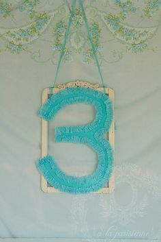 This number can be easily created using a board and crepe paper, hung with hem tape!
