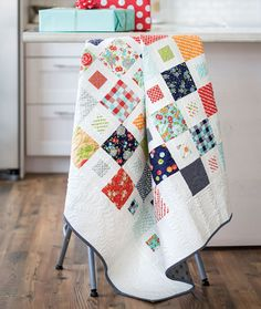 "This contemporary white quilt is just a hop, skip, and a jump away when you use pre-cut 5″ and 2½"" squares."