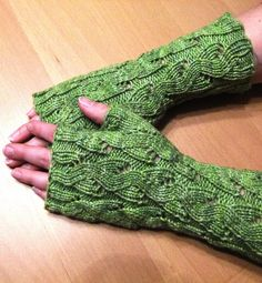 Free Knitting Pattern for Emilee Dee Mitts - The all-over pattern in Paula McKeever's fingerless mitts looks like cable but it's not – it's lace! Pictured project by bonniebeth