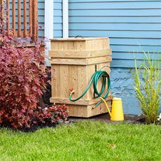 How to Build a Rain Barrel -Enclose a plastic bin with stock lumber to make a water-wise garden feature -By JOHN CASEYTHIS OLD HOUSE MAGAZINE
