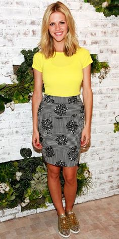 Brooklyn Decker hit the opening of the new Soho Splendid store in a bright yellow tee paired with a print skirt and glitter Miu Miu lace-ups.