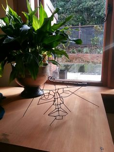 Small wire face sculpture by artist Paul Tulloch at ONE YORK