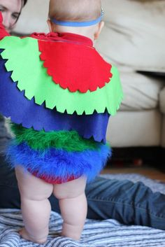 No-sew infant parrot costume tutorial.  So cute!  And check out those cute squishy baby legs.