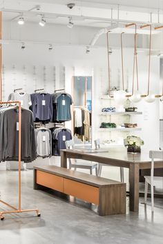 Studio Warm for Kit and Ace bespoke lighting installation above Supper Club table at London Redchurch Street store. Supper Club, Light Installation, Retail Design, Kit, Warm, Interior Design, Studio, Bespoke, Table