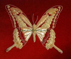 goldwork butterfly.JPG - Hand embroidery.  Goldwork.  Ist attempt at goldwork, I loved it!