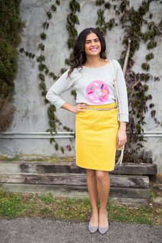 Spring outfit! Kate Spade donut sweatshirt glitter belt + Anthropologie yellow corduroy skirt + gray suede heels + quilted crossbody purse.