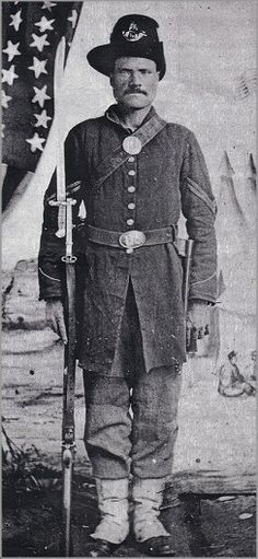 """Unknown soldier from the 6th Wisconsin Co. A showing the tall black """"hardee"""" hat, white gaiters and frock coat of the Iron Brigade."""