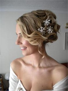 This hair style works mainly because the bride has very thick and long hair. The hair was rolled up to create the bob like length.  I then waved the hair with GHD's and left some soft pieces down. All the hair was sept over to the right hand side (right hand side is pictured) This makes for an unusual side style.