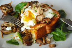 Poached eggs on brioche with garlicky mushrooms