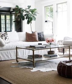 """The key to creating a timeless look is layering different textures and focusing on the details. The unique textures of the rugs, linen sofa and brass coffee table finished with organic elements like the leather pillow and indoor tree all working together to create an intriguing yet neutral space."" - @parkandoakdesign #MyOKLStyle #regram"