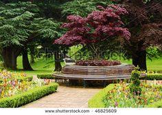 round bench planter around oak tree   Flower Beds Around Trees Formal flower garden,