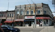 south-west corner Dundas Street West & Ossington, much of the area has changed but this small strip of shops remains the same