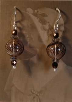 Ten% off from all earrings in April. Brown Glass Globe and sterling earrings by Foresthollow on Etsy, $38.00