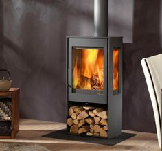 The Dik Geurts Kalle is a three sided glass wood burning stove allowing for views of the flames from around your living space. Small Wood Burning Stove, Outdoor Wood Burning Fireplace, Fireplace Logs, Fireplaces, Wood Paneling Makeover, Stove Installation, Multi Fuel Stove, Kitchen Dining Living, Wood Storage Box
