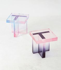 Working with transparent resin, Saerom Yoon designed a pair of tables where the clear resin takes on colorful gradients.