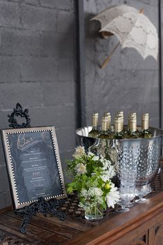 elegant bar setup, photo by Jarusha Brown http://ruffledblog.com/black-gold-calgary-wedding #weddingreception #weddingideas #bar