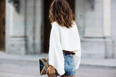 Cutoffs and a white blouse.
