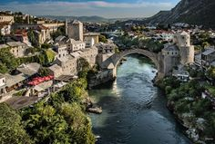Mostar, Bosnia.  I recognize this because my grandma made a painting of it years ago.  After standing over 400 years, the bridge was destroyed in '93 during the war and has since been reconstructed.