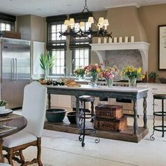 French country kitchen with black island