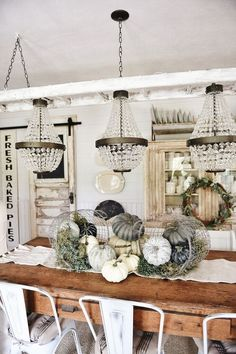 Beautiful fall centerpiece with pumpkins spilling from wire baskets