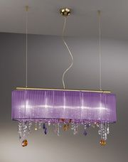 The absoloutely show stopping Paralume chandelier on a 24ct gold plated frame with purple silk taffeta shade with stunning coloured Swarovski crystal elements. Crystal colours can be chosen to suit your decor
