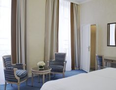 Deluxe Room - A quiet blue room on the inner courtyard