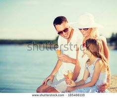 summer holidays, celebration, children and people concept - happy family eating ice cream - stock photo
