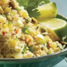Quinoa with Latin Flavors.        1 cup quinoa, (see Note)      2 teaspoons canola oil      1 medium onion, chopped      1 4-ounce can chopped green chiles      2 cloves garlic, minced      1 14-ounce can reduced-sodium chicken broth, or vegetable broth      1/4 cup pepitas, toasted (see Note)      3/4 cup coarsely chopped fresh cilantro      1/2 cup chopped scallions      2 tablespoons lime juice      1/4 teaspoon salt