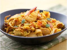 Chicken and seafood jambalaya | It is traditionally made in three parts, with meats and vegetables, and is completed by adding stock and rice.