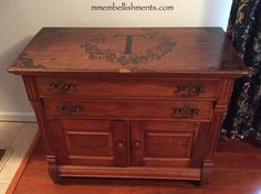 I used my trusted MinWax Ebony Stain to create this custom monogram for  a sweet little antique cupboard. The client had this little cupboard that needed some m…