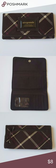 Apropos tale wallet. Brown plaid. Good condition. Bags Wallets
