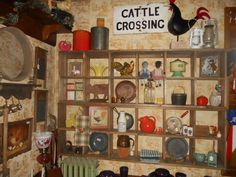 Old Hotel Market has eight rooms filled with eclectic finds. This is one of the walls in the rustic, country cabin room.