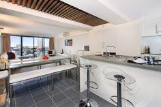 A contemporary kitchen / dining space in Surry Hills