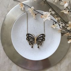 Large Butterfly Necklace Large Butterfly Necklace * Great condition  * Butterfly: 3in x 2.5 in  * Necklace length: 9in  * Peacock feathers  * Black / Gold  Styling tip: Dress up any top with this necklace ⚫️  Please, no trades, reasonable offers will be considered, & will ship within 1 business day ✨   5/16: uO12p7LO4-6m4 Other Jewelry Necklaces