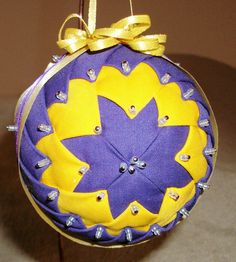 Grandmother's Quilt ~ Lions Club - Purple and Gold  ~~  ~ Quilt looking fabric ornaments made by Handcrafted by Denise.