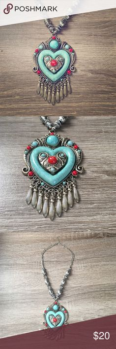 Beautiful Teal and Coral Necklace Brushed Silver Beautiful Teal and Coral Necklace Brushed Silver. Native American inspired, very Boho-chic and goes well with any outfit. Never worn. Make an offer. Or make a bundle. Buy 2 items and get 20% off. Everything must go no reasonable offer denied. We are a fast shipper and have all 5 star ratings. You won't be disappointed in the quality of this necklace or any other items in our closet. Take a look around! Lots of variety!! Jewelry Necklaces