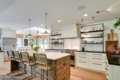 I'm not really a contemporary style fan, but I like open shelves for stacks of white dishes and deep drawers to pull out instead of cabinets below. Designer Lauren Liess's house for sale in Virginia